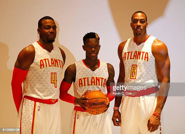 Paul Millsap Dennis Schroder and Dwight Howard of the Atlanta Hawks pose during media day on September 26 2016 in Atlanta Georgia
