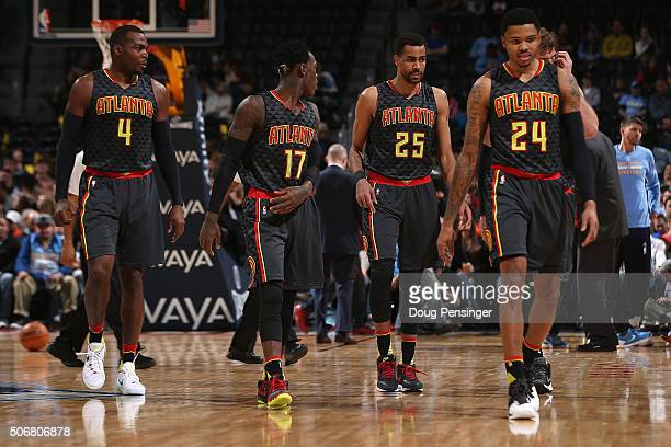 Paul Millsap Dennis Schroder Thabo Sefolosha and Kent Bazemore of the Atlanta Hawks take the court against the Denver Nuggets at Pepsi Center on...
