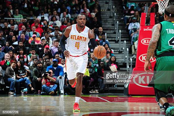 Paul Millsap of the Atlanta Hawks brings the ball up court against the Boston Celtics on April 9 2016 at Philips Arena in Atlanta Georgia NOTE TO...