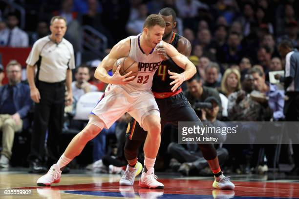 Paul Millsap of the Atlanta Hawks defends against Blake Griffin of the Los Angeles Clippers during the second half of a game at Staples Center on...