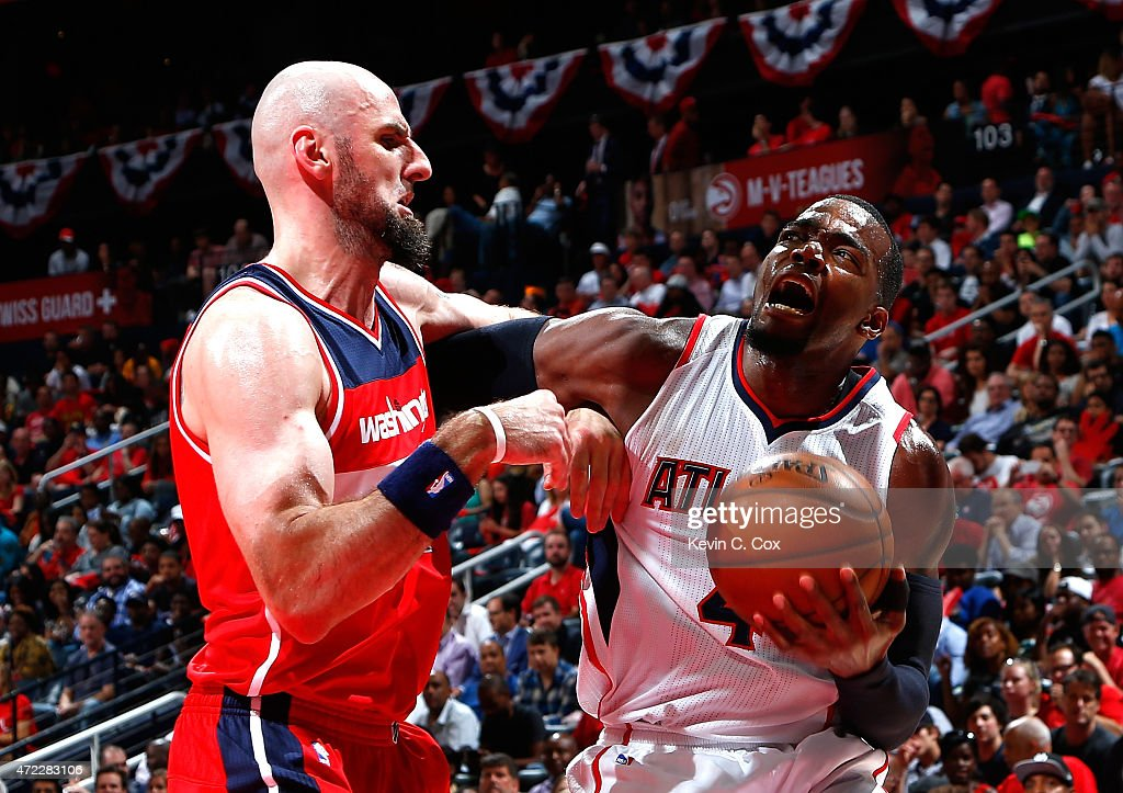 Paul Millsap of the Atlanta Hawks draws a foul from Marcin Gortat of the Washington Wizards during Game Two of the Eastern Conference Semifinals of...