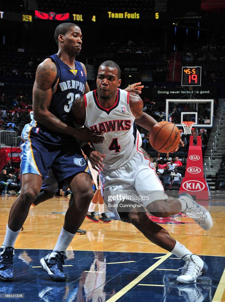<a gi-track='captionPersonalityLinkClicked' href=/galleries/search?phrase=Paul+Millsap&family=editorial&specificpeople=880017 ng-click='$event.stopPropagation()'>Paul Millsap</a> #4 of the Atlanta Hawks drives to the basket against the Memphis Grizzlies on October 20, 2013 at Philips Arena in Atlanta, Georgia.