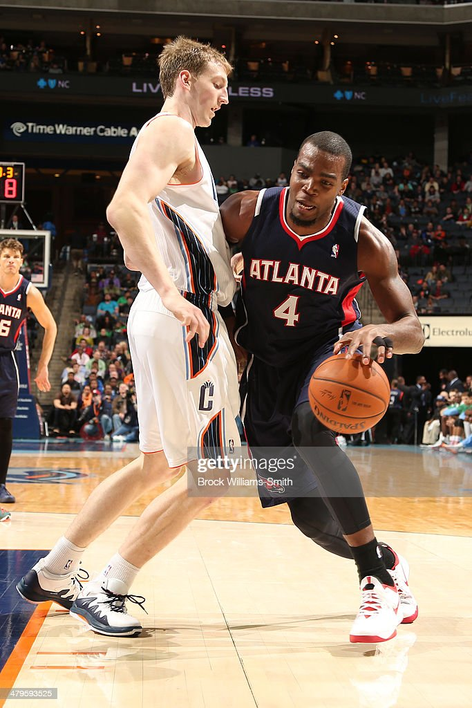 <a gi-track='captionPersonalityLinkClicked' href=/galleries/search?phrase=Paul+Millsap&family=editorial&specificpeople=880017 ng-click='$event.stopPropagation()'>Paul Millsap</a> #4 of the Atlanta Hawks drives to the basket against the Charlotte Bobcats during the game at the Time Warner Cable Arena on March 17, 2014 in Charlotte, North Carolina.