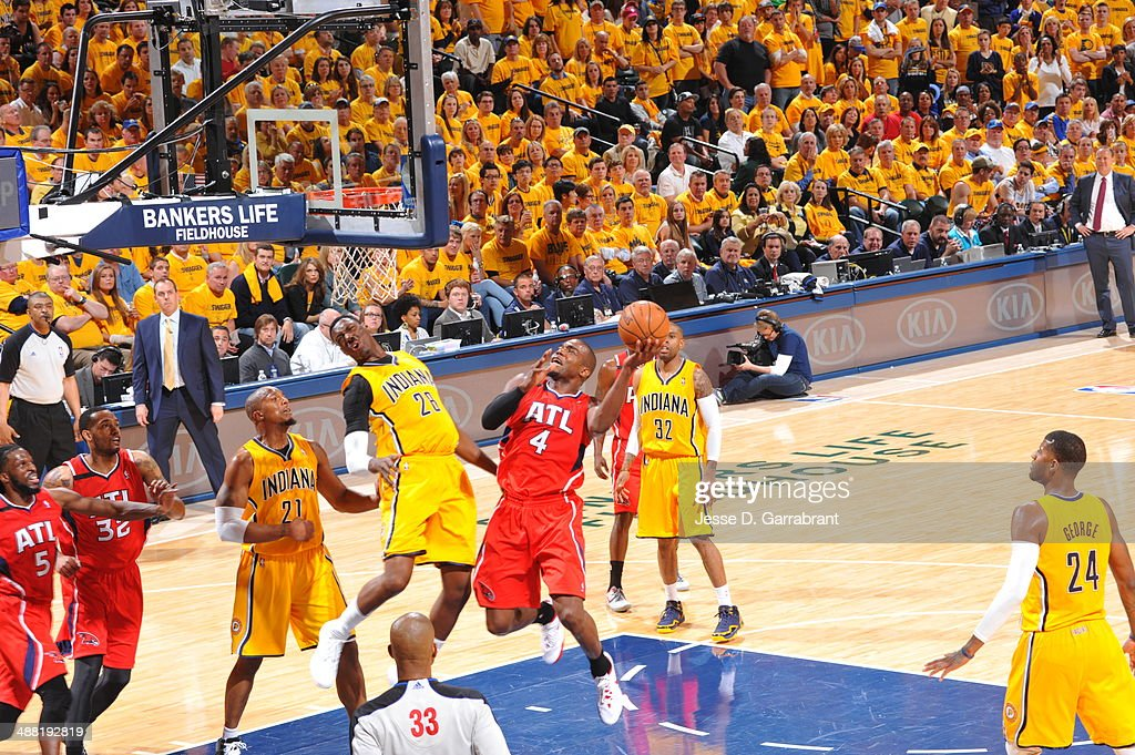 Paul Millsap #4 of the Atlanta Hawks drives to the basket against the Indiana Pacers during Game Seven of the Eastern Conference Quarterfinals during the 2014 NBA Playoffs on May 3, 2014 at Bankers Life Fieldhouse in Indianapolis, Indiana.