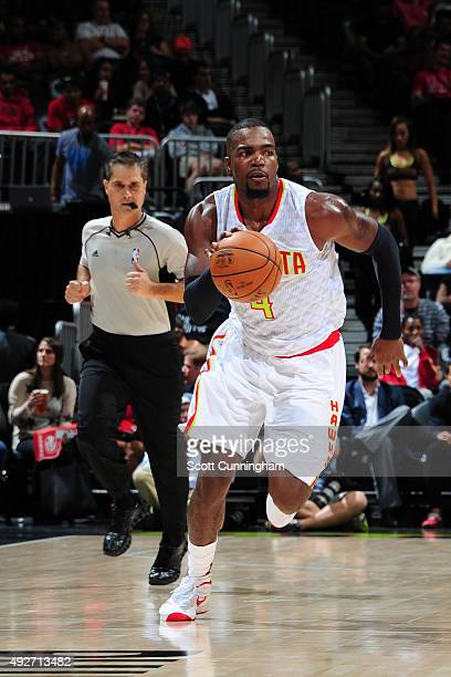 Paul Millsap of the Atlanta Hawks drives to the basket against the San Antonio Spurs on October 14 2015 at Philips Arena in Atlanta Georgia NOTE TO...