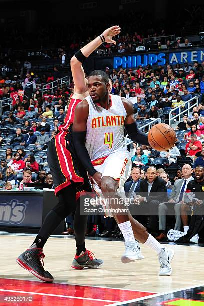 Paul Millsap of the Atlanta Hawks drives to the basket against the Miami Heat on October 18 2015 at Philips Arena in Atlanta Georgia NOTE TO USER...