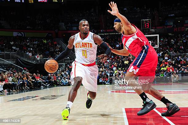 Paul Millsap of the Atlanta Hawks drives to the basket against the Washington Wizards during the game on November 7 2015 at Philips Arena in Atlanta...