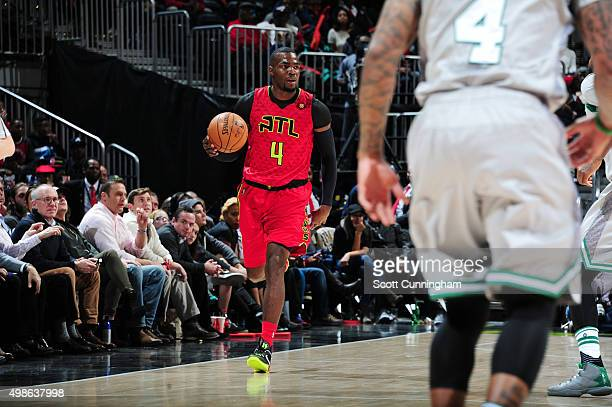 Paul Millsap of the Atlanta Hawks drives to the basket against the Boston Celtics during the game on November 24 2015 at Philips Arena in Atlanta...