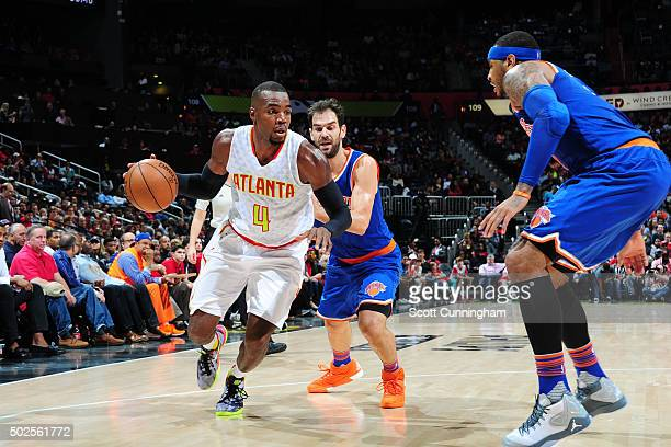 Paul Millsap of the Atlanta Hawks drives to the basket against the New York Knicks during the game on December 26 2015 at Philips Arena in Atlanta...