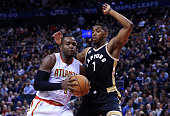 Paul Millsap of the Atlanta Hawks drives to the basket as Jason Thompson of the Toronto Raptors defends during the second half of an NBA game at the...