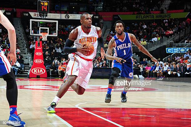 Paul Millsap of the Atlanta Hawks drives to the basket during the game phia 76ers on December 16 2015 at Philips Arena in Atlanta Georgia NOTE TO...