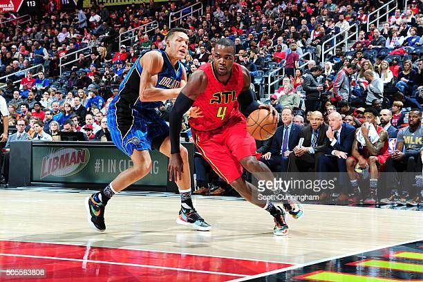 Paul Millsap of the Atlanta Hawks drives to the basket during the game against the Orlando Magic on January 18 2016 at Philips Arena in Atlanta...