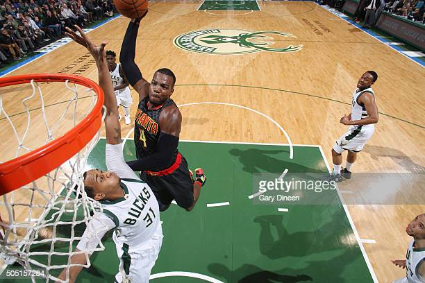 Paul Millsap of the Atlanta Hawks dunks against the Milwaukee Bucks on January 15 2016 at the BMO Harris Bradley Center in Milwaukee Wisconsin NOTE...