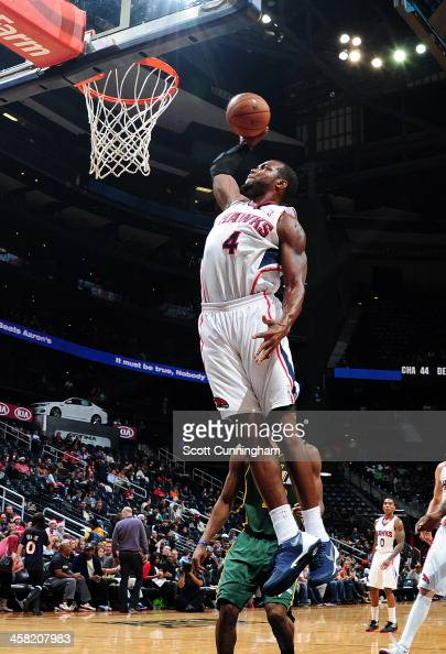 Paul Millsap of the Atlanta Hawks dunks the ball against the Utah Jazz on December 20 2013 at Philips Arena in Atlanta Georgia NOTE TO USER User...