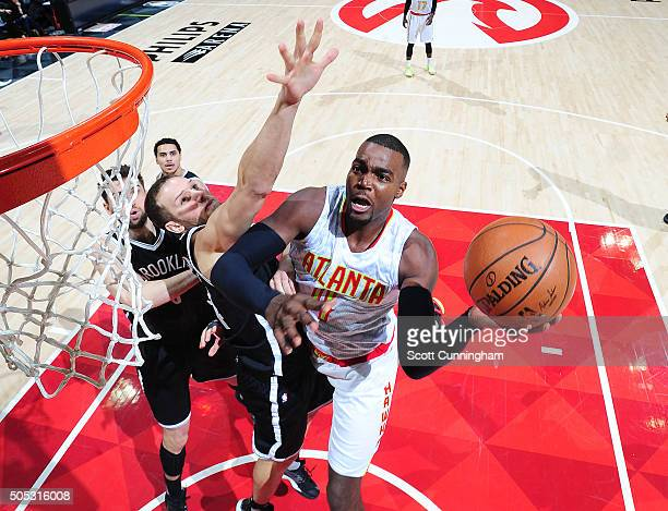 Paul Millsap of the Atlanta Hawks goes for the layup against the Brooklyn Nets during the game on January 16 2016 at Philips Arena in Atlanta Georgia...