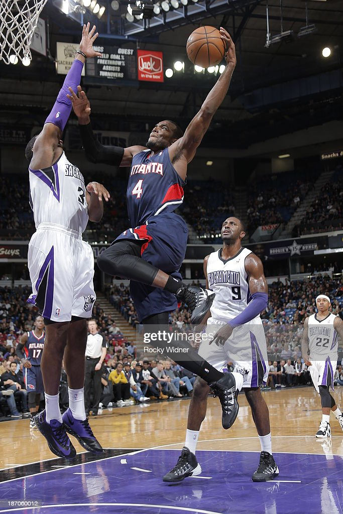 Paul Millsap #4 of the Atlanta Hawks goes to the basket against Jason Thompson #34 of the Sacramento Kings at Sleep Train Arena on November 5, 2013 in Sacramento, California.
