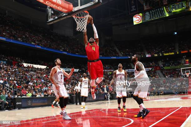 Paul Millsap of the Atlanta Hawks goes up for a dunk during a game against the Cleveland Cavaliers on April 9 2017 at Philips Arena in Atlanta...