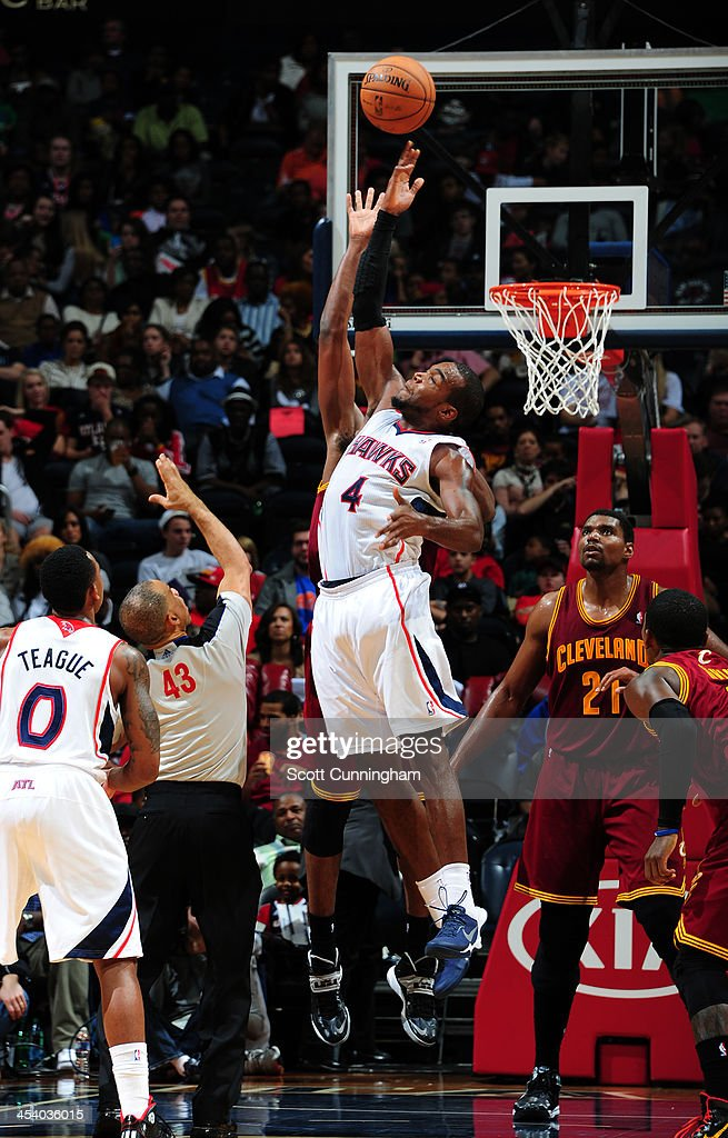 <a gi-track='captionPersonalityLinkClicked' href=/galleries/search?phrase=Paul+Millsap&family=editorial&specificpeople=880017 ng-click='$event.stopPropagation()'>Paul Millsap</a> #4 of the Atlanta Hawks goes up for a rebound against the Cleveland Cavaliers on December 6, 2013 at Philips Arena in Atlanta, Georgia.