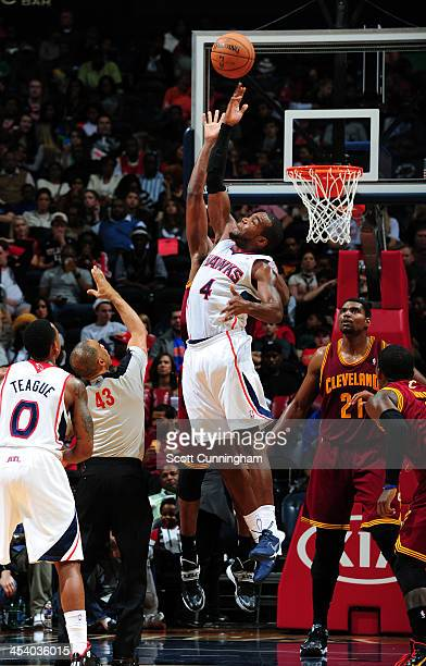 Paul Millsap of the Atlanta Hawks goes up for a rebound against the Cleveland Cavaliers on December 6 2013 at Philips Arena in Atlanta Georgia NOTE...