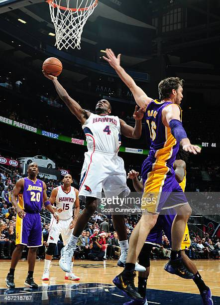 Paul Millsap of the Atlanta Hawks goes up for the shot against the Los Angeles Lakers on December 16 2013 at Philips Arena in Atlanta Georgia NOTE TO...
