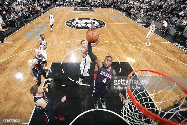 Paul Millsap of the Atlanta Hawks grabs the rebound against the Brooklyn Nets in Game Six of the Eastern Conference Quarterfinals during the 2015 NBA...