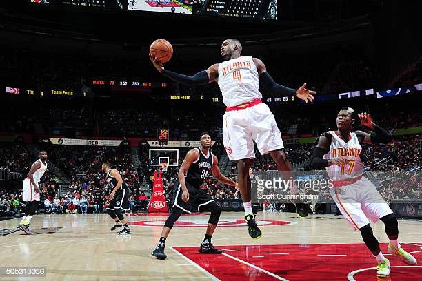 Paul Millsap of the Atlanta Hawks grabs the rebound against the Brooklyn Nets during the game on January 16 2016 at Philips Arena in Atlanta Georgia...
