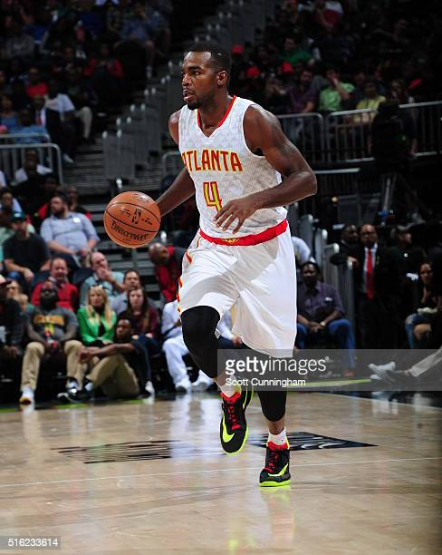 Paul Millsap of the Atlanta Hawks handles the ball against the Denver Nuggets on March 17 2016 at Philips Arena in Atlanta Georgia NOTE TO USER User...