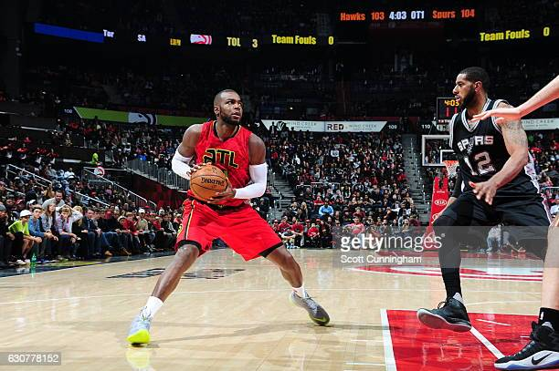 Paul Millsap of the Atlanta Hawks handles the ball against the San Antonio Spurs on January 1 2017 at Philips Arena in Atlanta Georgia NOTE TO USER...