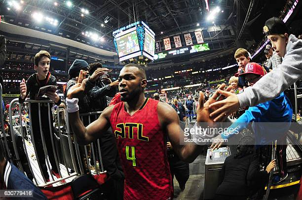 Paul Millsap of the Atlanta Hawks is seen high fiving fans after the game against the San Antonio Spurs on January 1 2017 at Philips Arena in Atlanta...