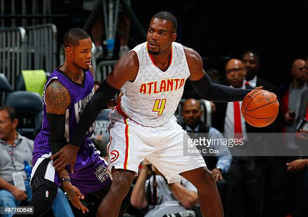 Paul Millsap of the Atlanta Hawks looks to drive against Ben McLemore of the Sacramento Kings at Philips Arena on November 18 2015 in Atlanta Georgia...