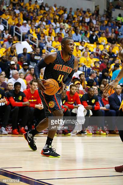 Paul Millsap of the Atlanta Hawks looks to move the ball against the Cleveland Cavaliers during a preseason game on October 7 2015 at Cintas Center...