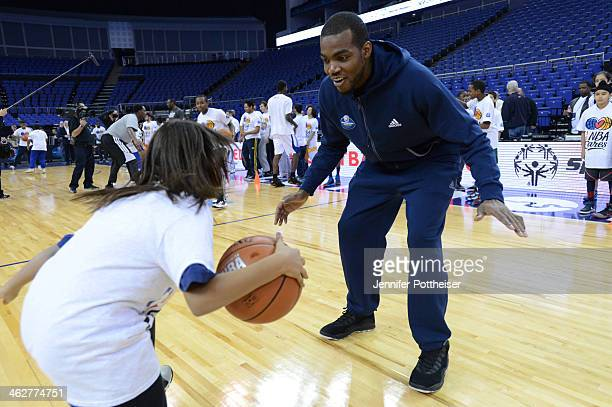 Paul Millsap of the Atlanta Hawks participate in drills during the NBA Cares Unified Basketball Clinic as part of the 2014 Global Games on January 15...
