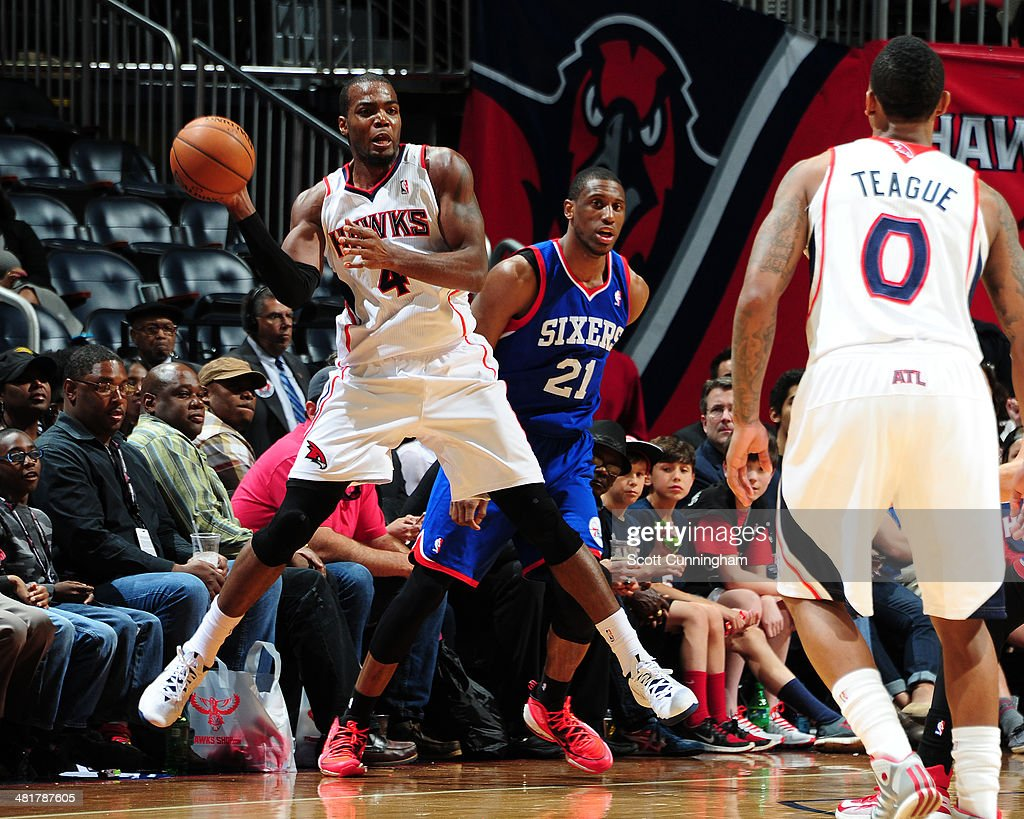 <a gi-track='captionPersonalityLinkClicked' href=/galleries/search?phrase=Paul+Millsap&family=editorial&specificpeople=880017 ng-click='$event.stopPropagation()'>Paul Millsap</a> #4 of the Atlanta Hawks passes the ball against the Philadelphia 76ers on March 31, 2014 at Philips Arena in Atlanta, Georgia.