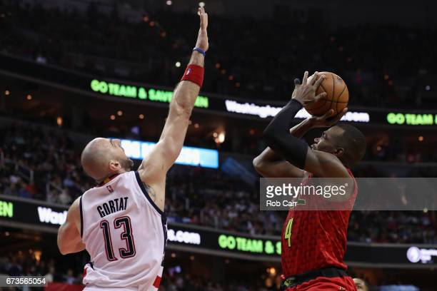 Paul Millsap of the Atlanta Hawks puts up a shot in front of Marcin Gortat of the Washington Wizards in the second half in Game Five of the Eastern...