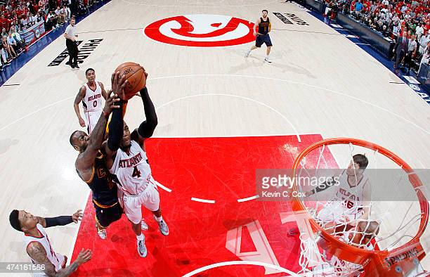 Paul Millsap of the Atlanta Hawks rebounds against LeBron James of the Cleveland Cavaliers in the second half during Game One of the Eastern...