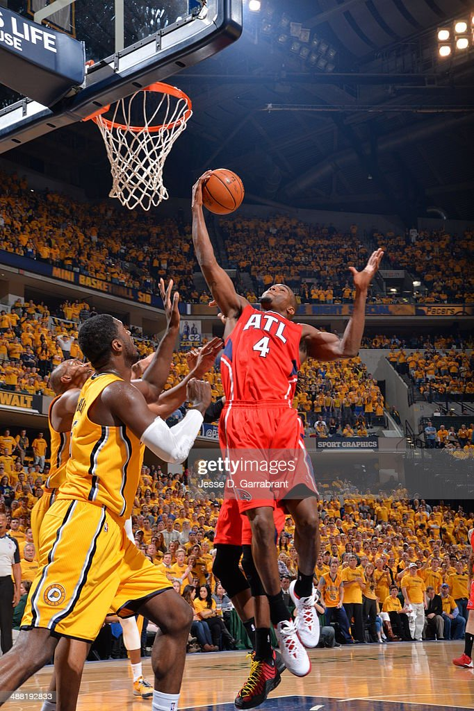 Paul Millsap #4 of the Atlanta Hawks rebounds the ball against the Indiana Pacers during Game Seven of the Eastern Conference Quarterfinals during the 2014 NBA Playoffs on May 3, 2014 at Bankers Life Fieldhouse in Indianapolis, Indiana.