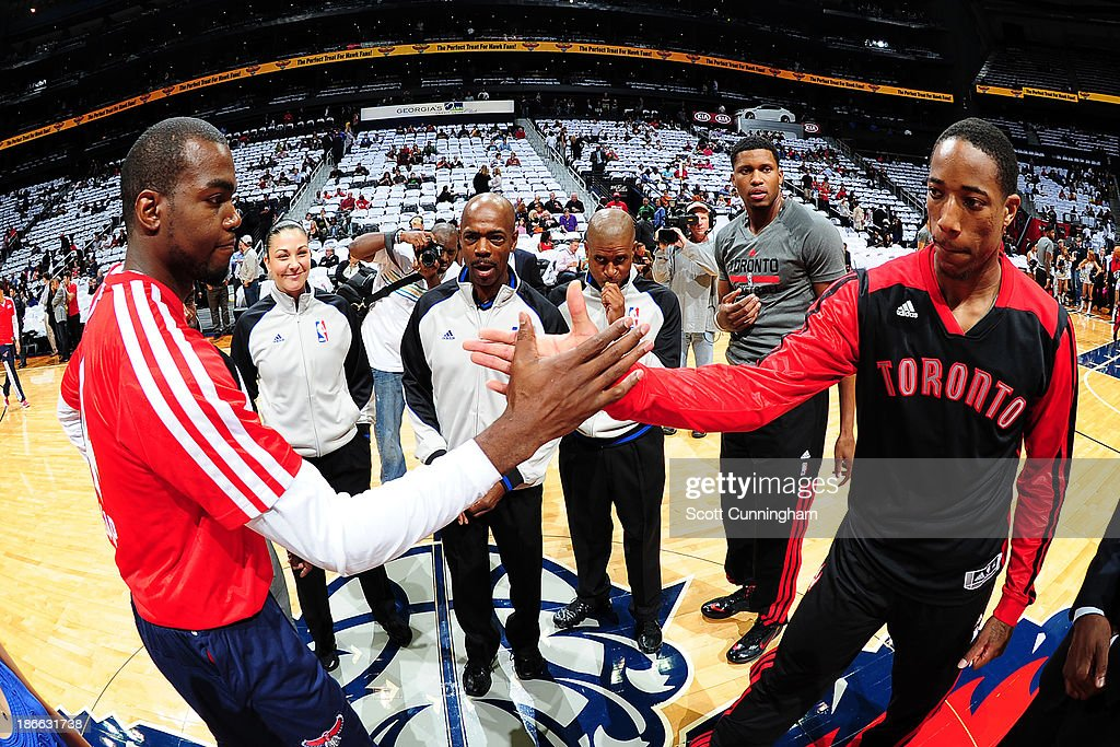 <a gi-track='captionPersonalityLinkClicked' href=/galleries/search?phrase=Paul+Millsap&family=editorial&specificpeople=880017 ng-click='$event.stopPropagation()'>Paul Millsap</a> #4 of the Atlanta Hawks shakes hands with DeMar DeRozan #10 of the Toronto Raptors before the game on November 1, 2013 at Philips Arena in Atlanta, Georgia.