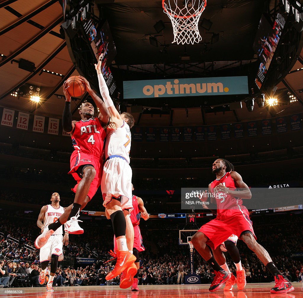 Paul Millsap #4 of the Atlanta Hawks shoots against Andrea Bargnani during a game at Madison Square Garden in New York City.