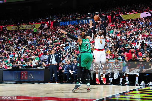 Paul Millsap of the Atlanta Hawks shoots against Jared Sullinger of the Boston Celtics on April 9 2016 at Philips Arena in Atlanta Georgia NOTE TO...