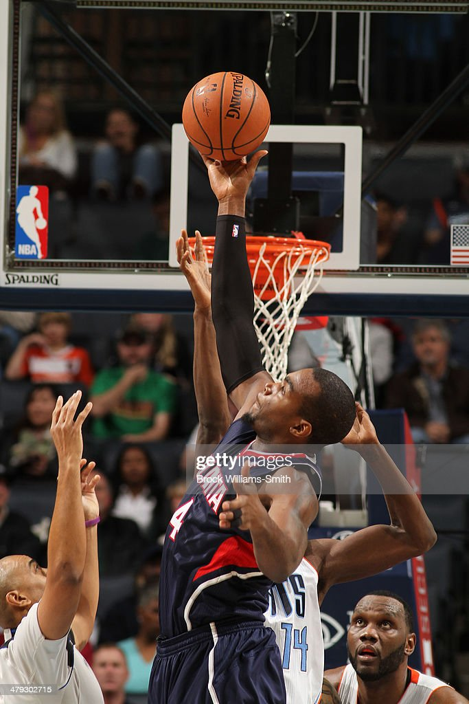 Paul Millsap #4 of the Atlanta Hawks shoots against the Charlotte Bobcats during the game at the Time Warner Cable Arena on March 17, 2014 in Charlotte, North Carolina.