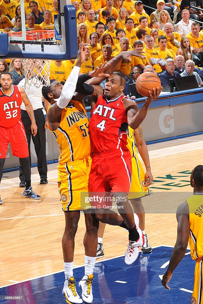Paul Millsap #4 of the Atlanta Hawks shoots against the Indiana Pacers in Game Seven of the Eastern Conference Quarterfinals during the 2014 NBA Playoffs on May 3, 2014 at Bankers Life Fieldhouse in Indianapolis, Indiana.