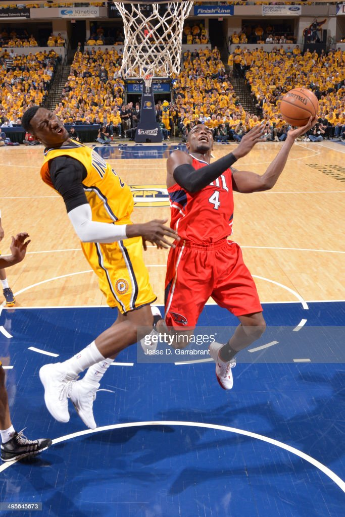 <a gi-track='captionPersonalityLinkClicked' href=/galleries/search?phrase=Paul+Millsap&family=editorial&specificpeople=880017 ng-click='$event.stopPropagation()'>Paul Millsap</a> #4 of the Atlanta Hawks shoots against the Indiana Pacers in Game Seven of the Eastern Conference Quarterfinals during the 2014 NBA Playoffs on May 3, 2014 at Bankers Life Fieldhouse in Indianapolis, Indiana.