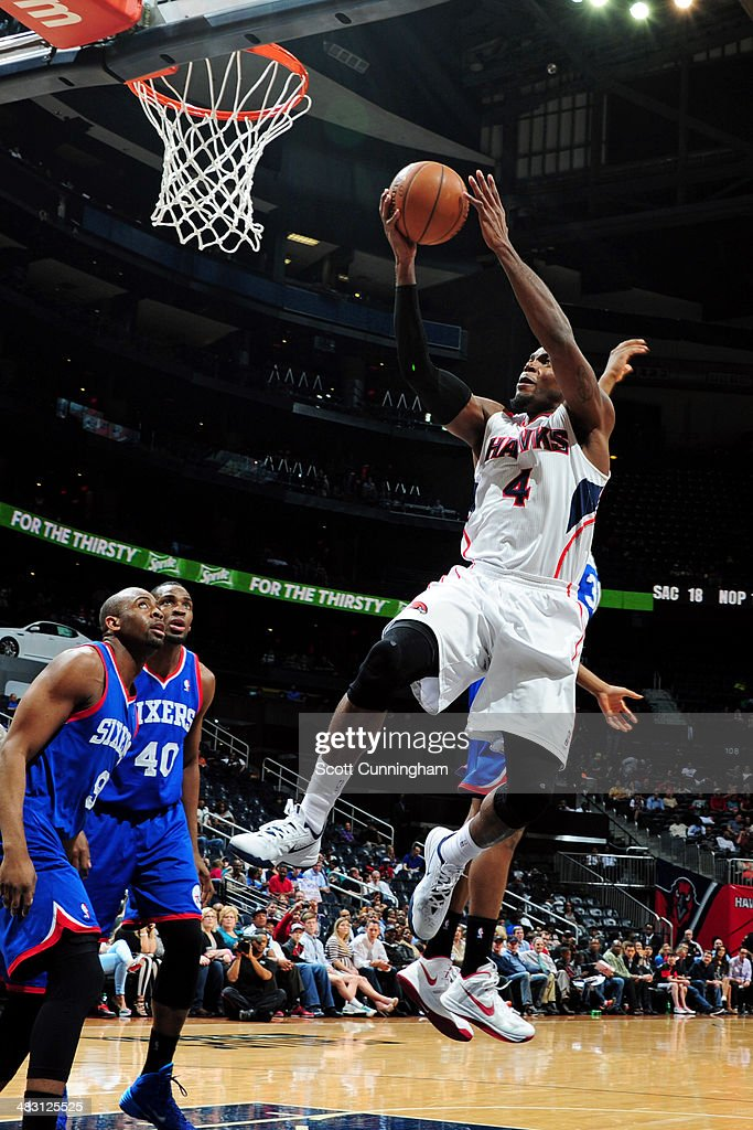 <a gi-track='captionPersonalityLinkClicked' href=/galleries/search?phrase=Paul+Millsap&family=editorial&specificpeople=880017 ng-click='$event.stopPropagation()'>Paul Millsap</a> #4 of the Atlanta Hawks shoots against the Philadelphia 76ers on March 31, 2014 at Philips Arena in Atlanta, Georgia.