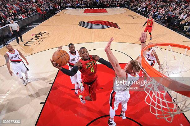 Paul Millsap of the Atlanta Hawks shoots against the Portland Trail Blazers during the game on January 20 2016 at Moda Center in Portland Oregon NOTE...