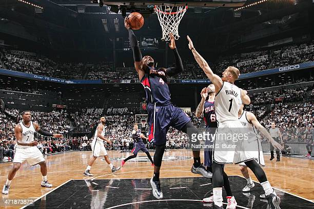 Paul Millsap of the Atlanta Hawks shoots the ball against the Brooklyn Nets in Game Six of the Eastern Conference Quarterfinals during the 2015 NBA...