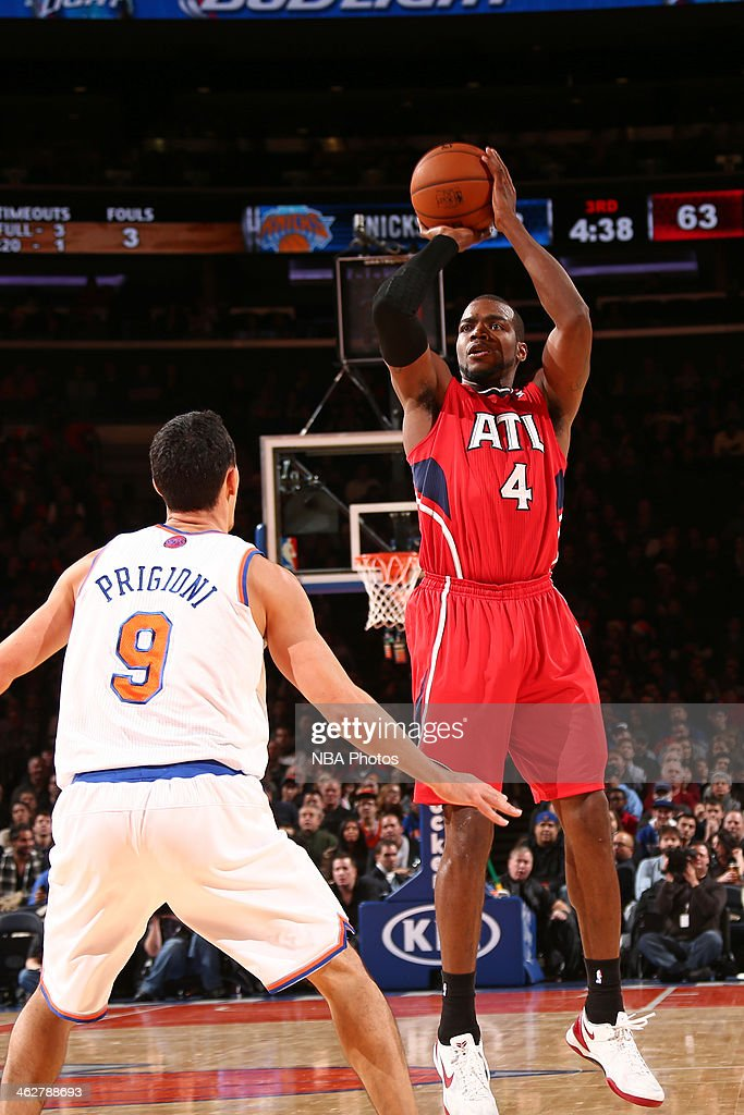 <a gi-track='captionPersonalityLinkClicked' href=/galleries/search?phrase=Paul+Millsap&family=editorial&specificpeople=880017 ng-click='$event.stopPropagation()'>Paul Millsap</a> #4 of the Atlanta Hawks shoots the ball against the New York Knicks during a game at Madison Square Garden in New York City.