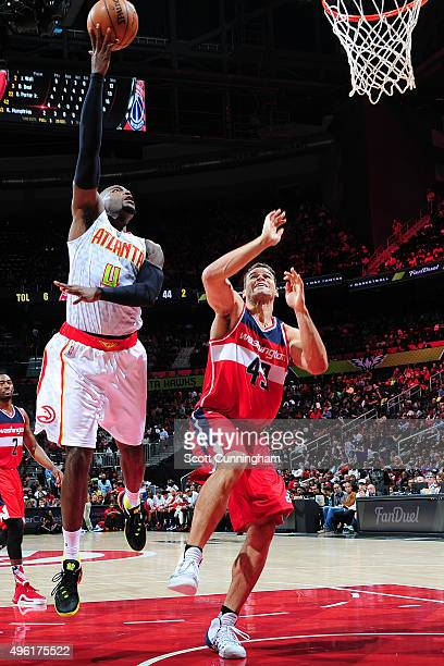 Paul Millsap of the Atlanta Hawks shoots the ball against the Washington Wizards during the game on November 7 2015 at Philips Arena in Atlanta...