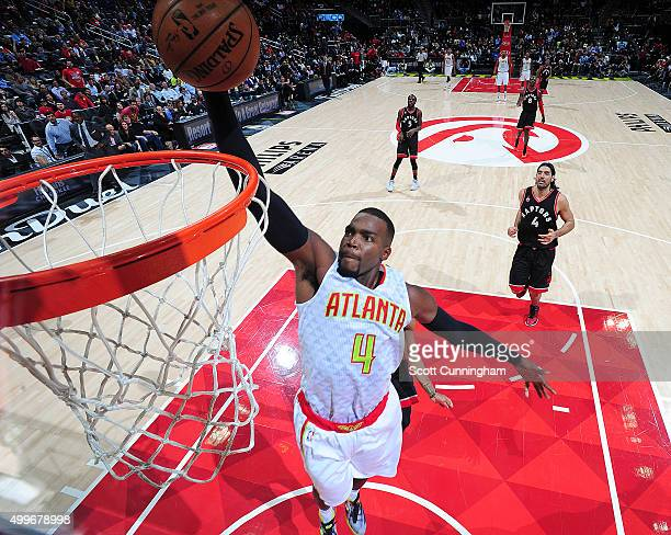 Paul Millsap of the Atlanta Hawks shoots the ball during the game against the Toronto Raptors on December 2 2015 at Philips Arena in Atlanta Georgia...