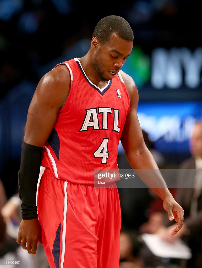 Paul Millsap #4 of the Atlanta Hawks walks off the court during a time out in the second half against the Brooklyn Nets at the Barclays Center on January 6, 2014 in the Brooklyn borough of New York City.The Brooklyn Nets defeated the Atlanta Hawks 91-86.