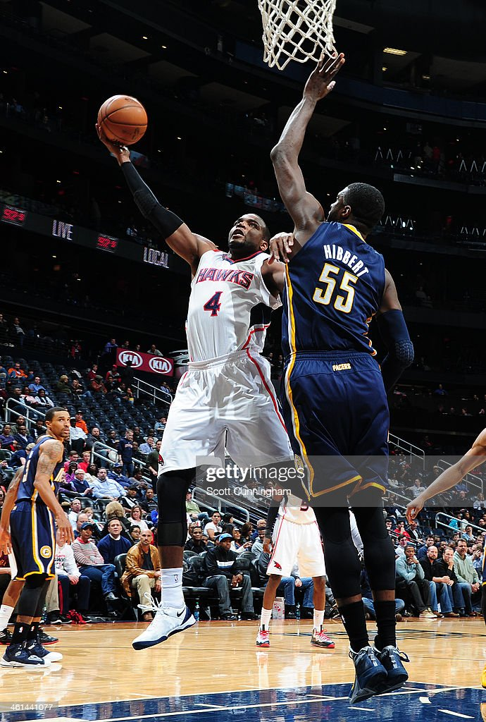 Paul Millsap #4 of the Atlanta Hawks with a shot attempt during a game against the Indiana Pacers of the Atlanta Hawks against of the Indiana Pacers on January 8, 2014 at Philips Arena in Atlanta, Georgia.